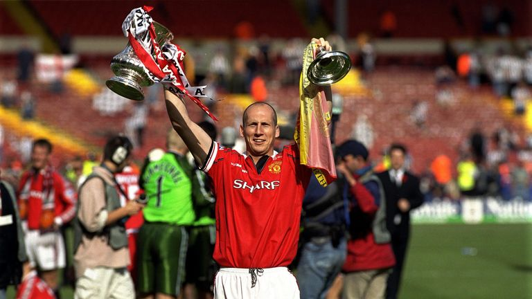 Jaap Stam lifts the FA Cup in 1999 on his way to a treble with Manchester United