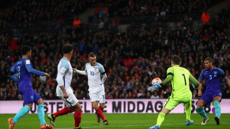 LONDON, ENGLAND - MARCH 29:  Jamie Vardy (c) of England scores the opening goal past Jeroen Zoet