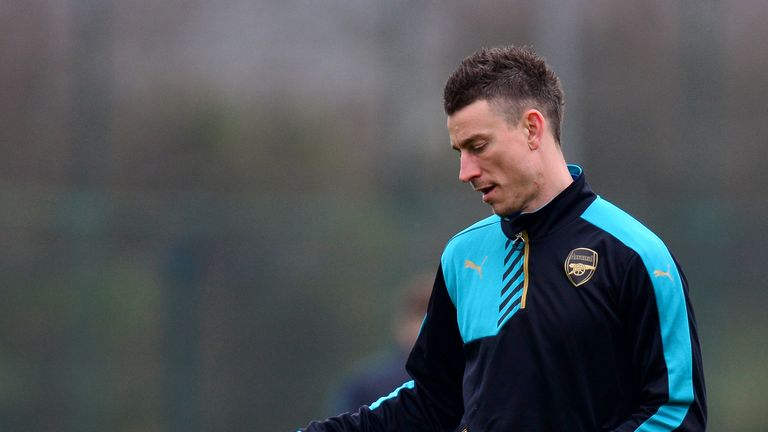ST ALBANS, ENGLAND - MARCH 15:  Laurent Koscielny of Arsenal passes a ball during a training session ahead of the UEFA Champions League round of 16 second