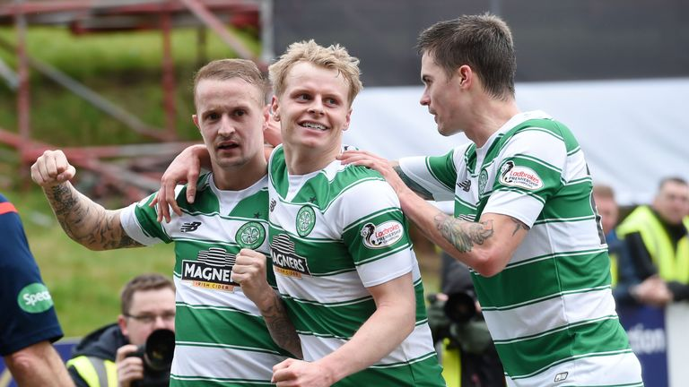 Celtic hitman Leigh Griffiths (left) celebrates his opening goal with Gary Mackay-steven (centre) and Mikael Lustig
