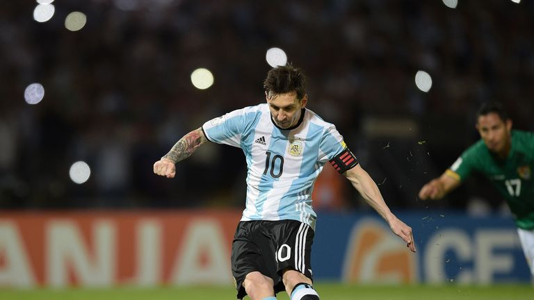 Argentina's Lionel Messi takes a penalty to score against Bolivia