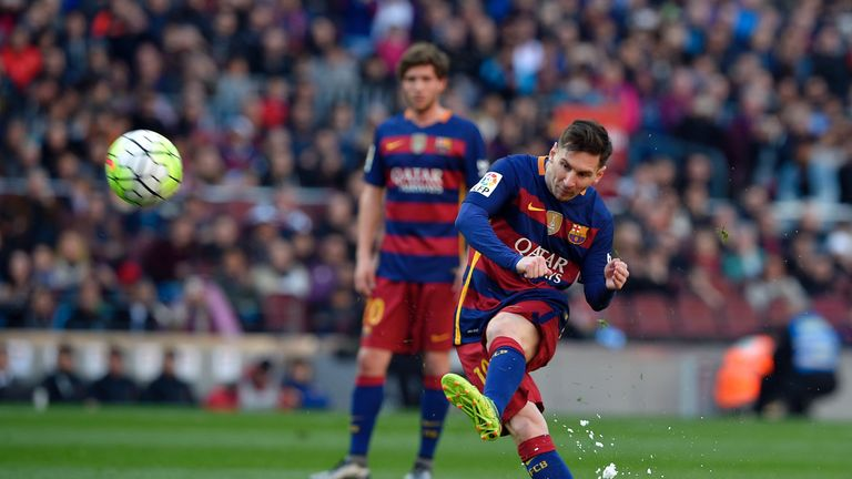 Barcelona's Lionel Messi kicks the ball