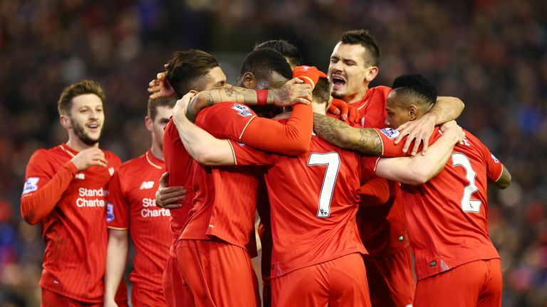James Milner is mobbed by team-mates after goal