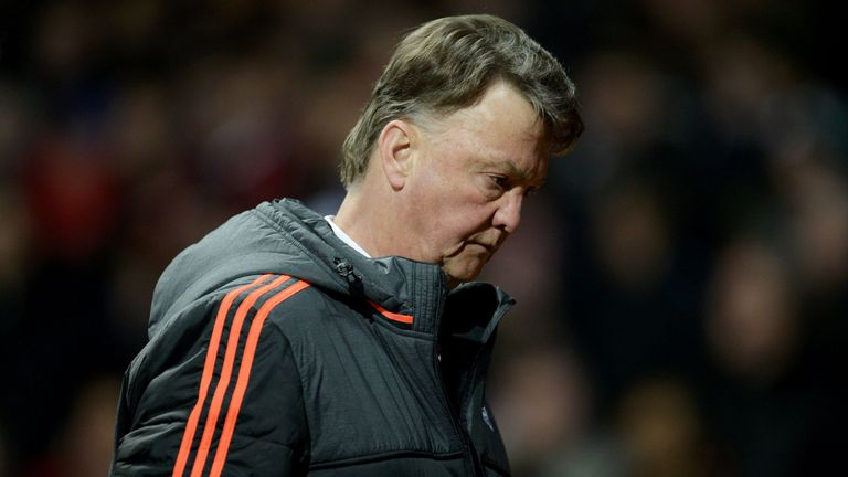 Louis van Gaal leaves at half-time during the UEFA Europa League round of 16, second leg football match between Manchester United and Liverpool