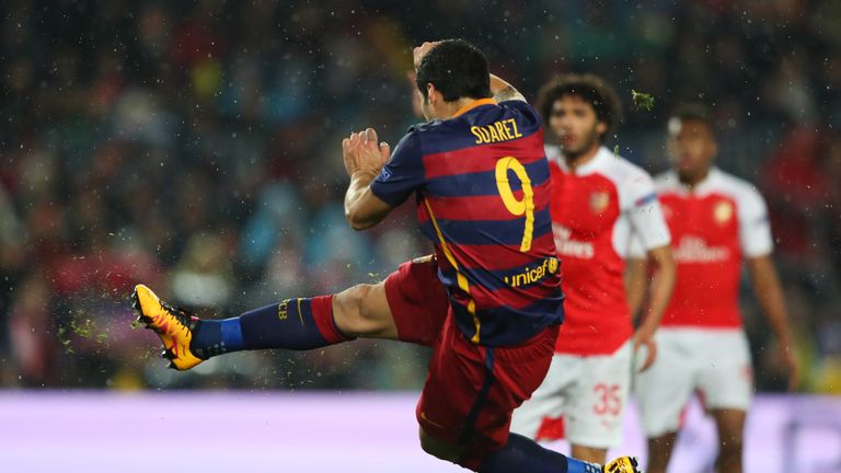 Luis Suarez of Barcelona scores his team's second goal during the UEFA Champions League round of 16, second Leg match v Arsenal