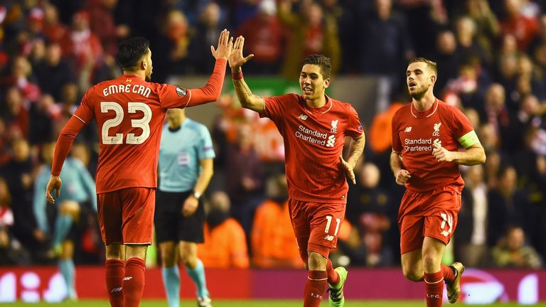 Roberto Firmino celebrates after scoring for Liverpool against Manchester United
