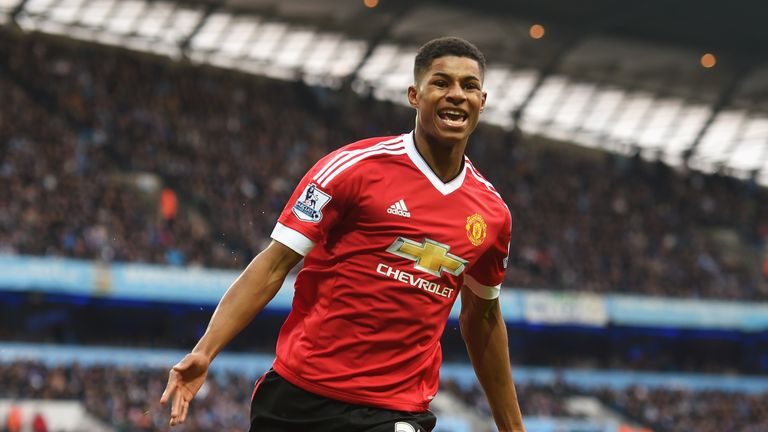 Marcus Rashford of Manchester United celebrates the first goal in the derby