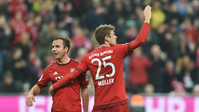 Bayern Munich's midfielder Thomas Mueller (R) celebrates scoring the 2-0 goal with Bayern Munich's midfielder Mario Goetze