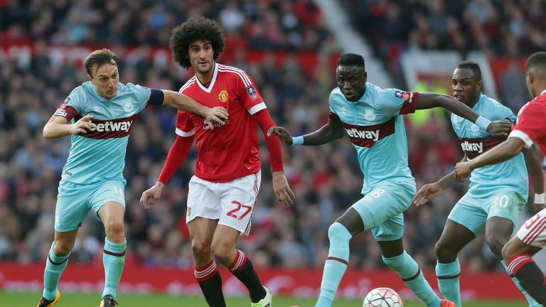 Marouane Fellaini of Manchester United in action with Mark Noble of West Ham United