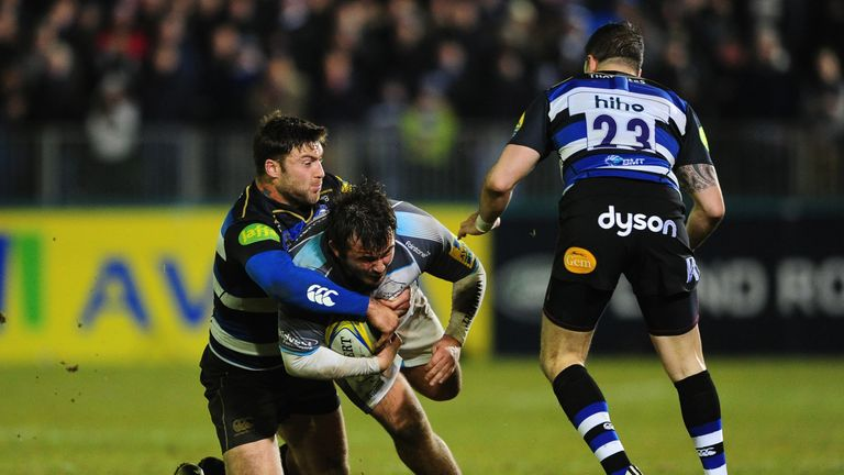 Newcastle's George McGuigan is tackled by Matt Banahan of Bath