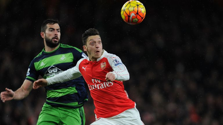 Did Jordi Amat (left) foul Mesut Ozil in the lead-up to Swansea's first goal