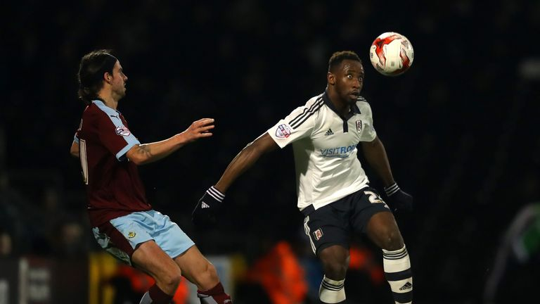 Moussa Dembele keeps the ball away from George Boyd