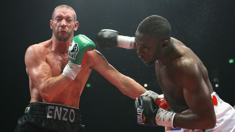 Afolabi lands a right hand on Enzo Maccarinelli during their showdown in Manchester in 2009