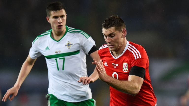 Paddy McNair (l) and Sam Vokes of Wales do battle in Cardiff