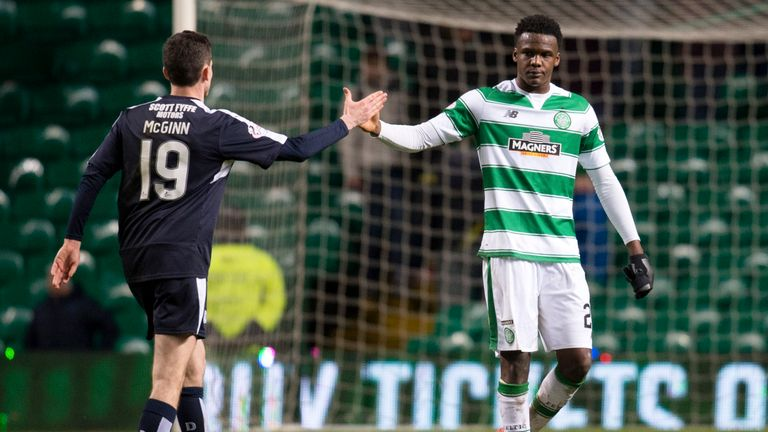 Celtic's Dedryck Boyata (right) with Paul McGinn at full-time