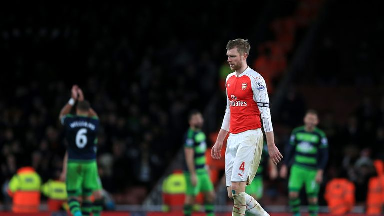 Arsenal's Per Mertesacker is left dejected