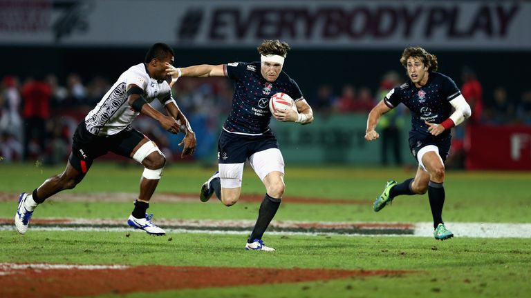 Phil Burgess of England in action against during the Dubai Rugby Sevens