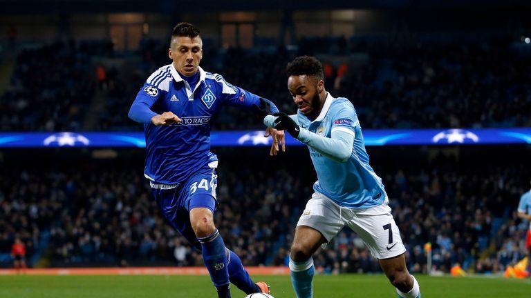 Manchester City's Raheem Sterling and Dynamo Kiev's Yevhen Khacheridi battle for the ball