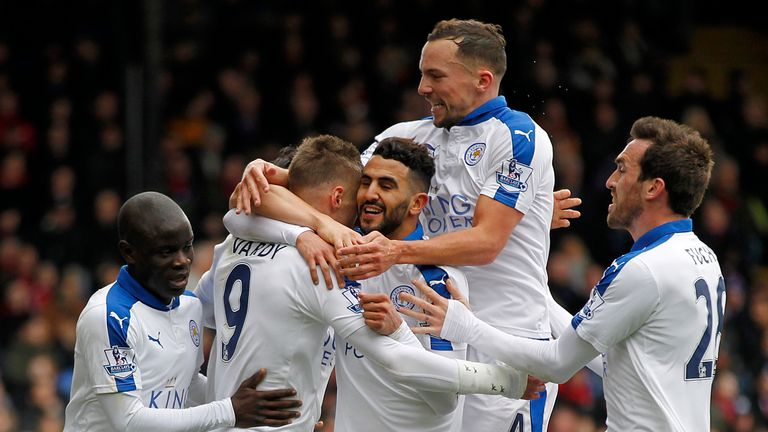 Leicester players mob Riyad Mahrez after his winning goal against Crystal Palace