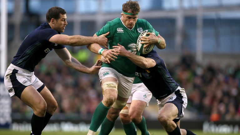 Jamie Heaslip is tackled by Scotland's Alex Dunbar (right) and Tim Visser