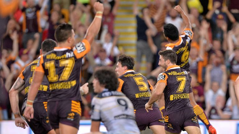 Anthony Milford leads the celebrations after kicking the winning field goal against the Cowboys