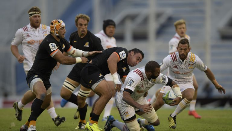 Chiefs No 8 Michael Leitch (second right) is tackled by Jaguares hooker Agustin Creevy
