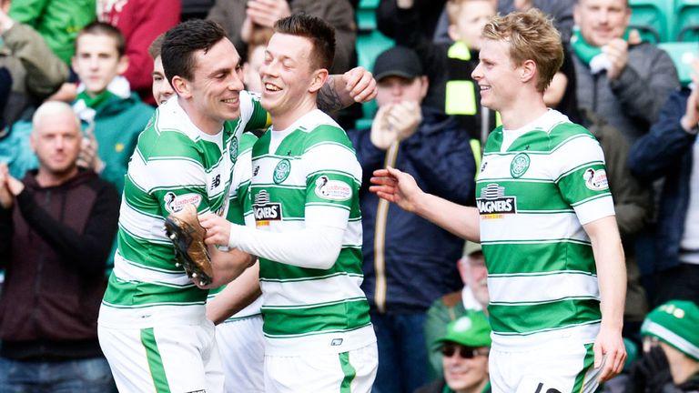 Callum McGregor (c) is congratulated after scoring Celtic's third goal