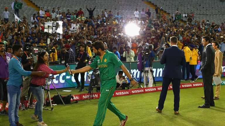 Shahid Afridi walks away after being interviewed, following the Australia T20 game