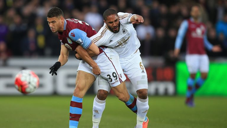 Rudy Gestede and Ashley Williams compete for the ball