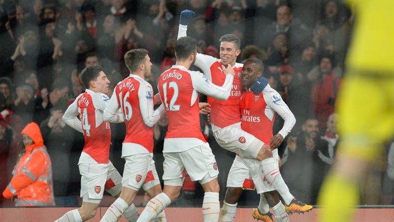 Joel Campbell is congratulated after scoring for Arsenal against Swansea