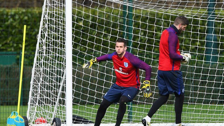 Tom Heaton (left) is put through his paces at England training