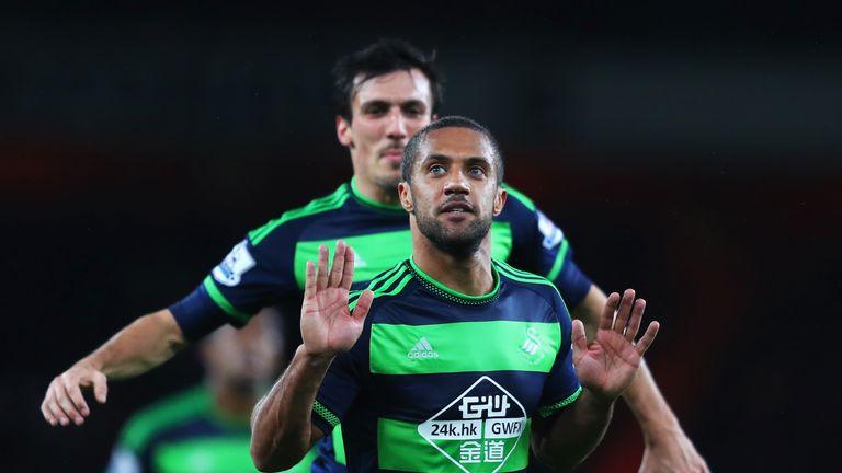 Swansea's Wayne Routledge celebrates after scoring against Arsenal