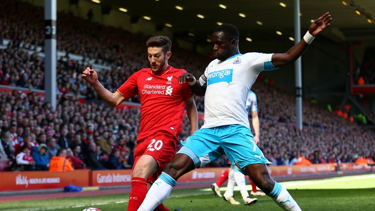 Moussa Sissoko of Newcastle makes a challenge on Adam Lallana
