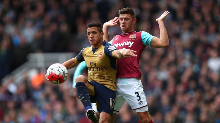 Alexis Sanchez  controls the ball under pressure from Aaron Cresswell