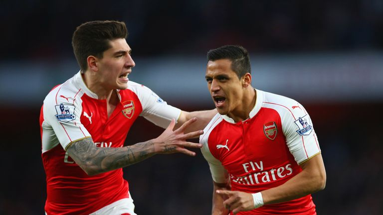 Alexis Sanchez of Arsenal (R) celebrates with Hector Bellerin as he scores their first goal during the Barclays Premier League match v West Brom