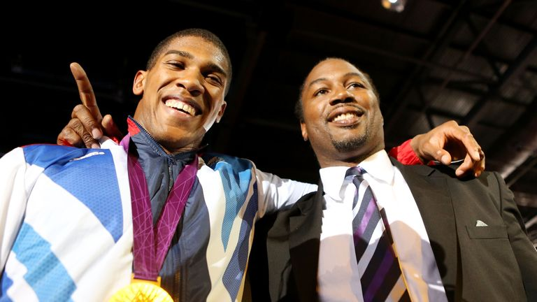 Gold medalist Anthony Joshua (L) of Great Britain celebrates with former world heavweight boxing champion and fellow countrym