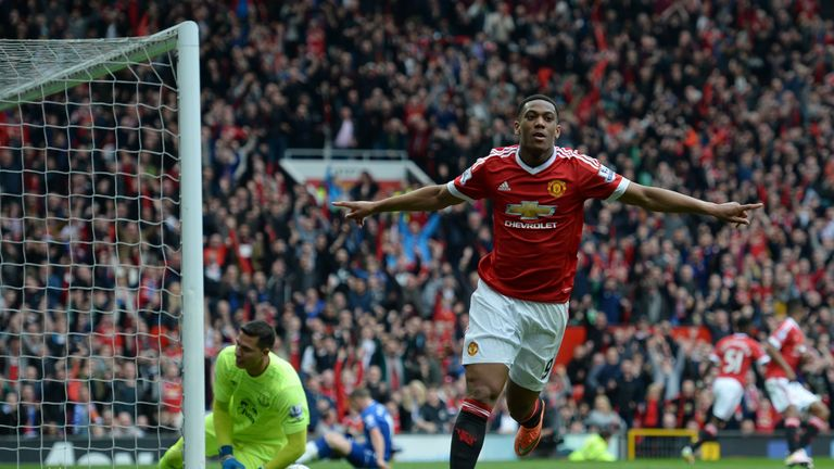 Manchester United's French striker Anthony Martial turns to celebrate after scoring the opening goal