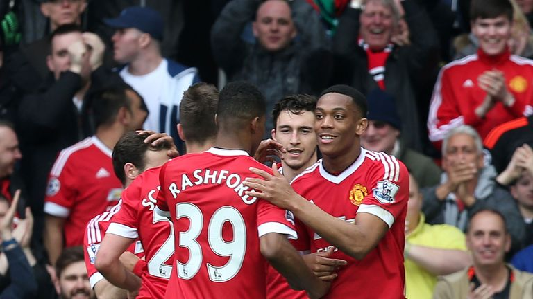 Anthony Martial of Manchester United celebrates scoring their first goal during the Barclays Premier League match