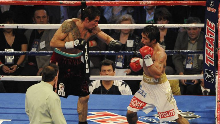 Margarito (L) towered over Pacquiao but was outgunned