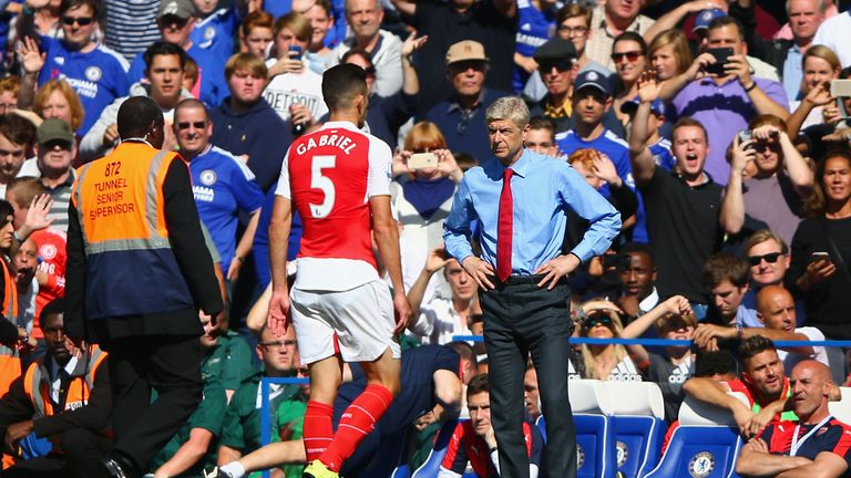 Gabriel leaves the pitch after being sent off against Chelsea