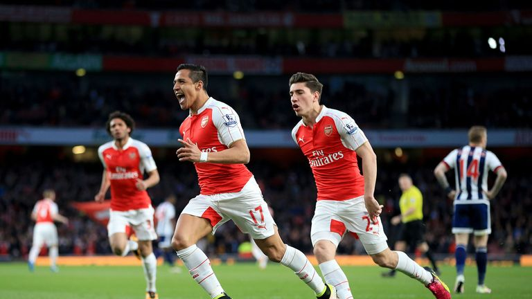 Arsenal's Alexis Sanchez (centre left) celebrates scoring their first goal of the game the Barclays Premier League match at the Emirates Stadium, London. P