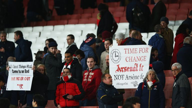 LONDON, ENGLAND - APRIL 21:  Arsenal fans hold banners after the Barclays Premier League match between Arsenal and West Bromwich Albion at the Emirates Sta