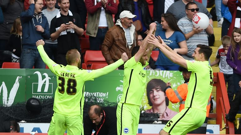 Brighton and Hove Albion's Sam Baldock (centre) celebrates scoring their first goal during the Sky Bet Championship match at The Valley, Charlton.