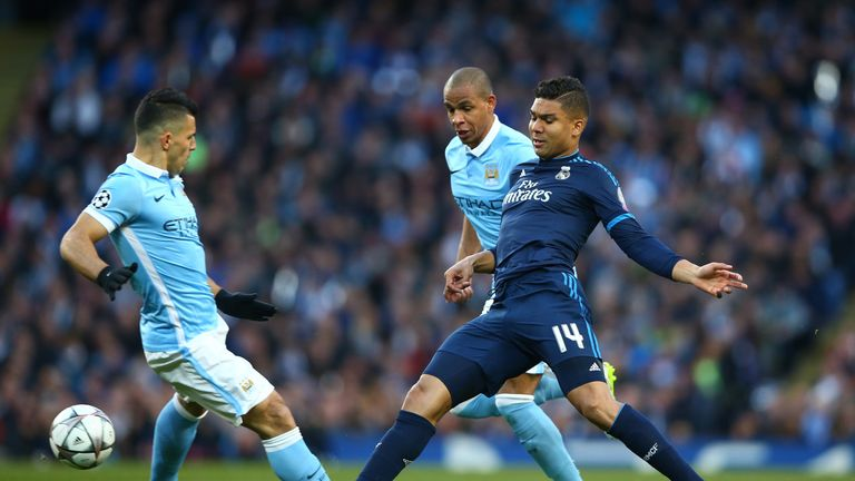 Casemiro of Real Madrid CF is closed down by Sergio Aguero of Manchester City
