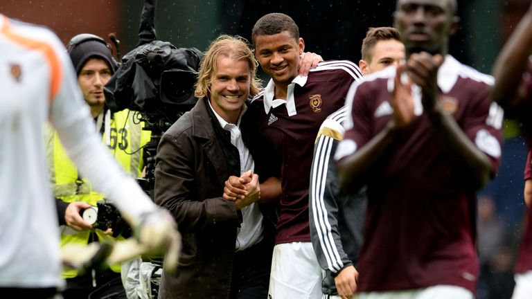 Hearts head coach Robbie Neilson (left) celebrates with match winner Osman Sow after their 2-1 win at Ibrox.