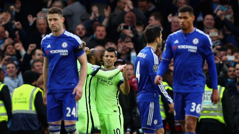 Sergio Aguero of Manchester City celebrates with team mates following scoring his sides third goal against Chelsea
