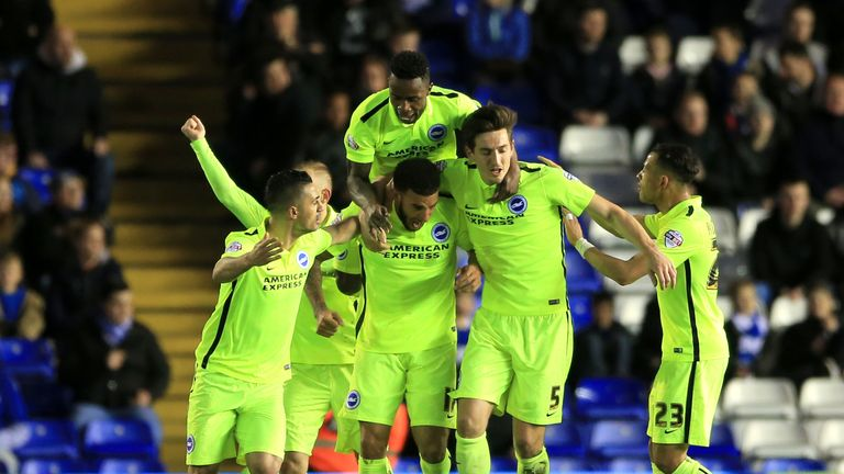 Brighton's Connor Goldson (centre) celebrates after scoring