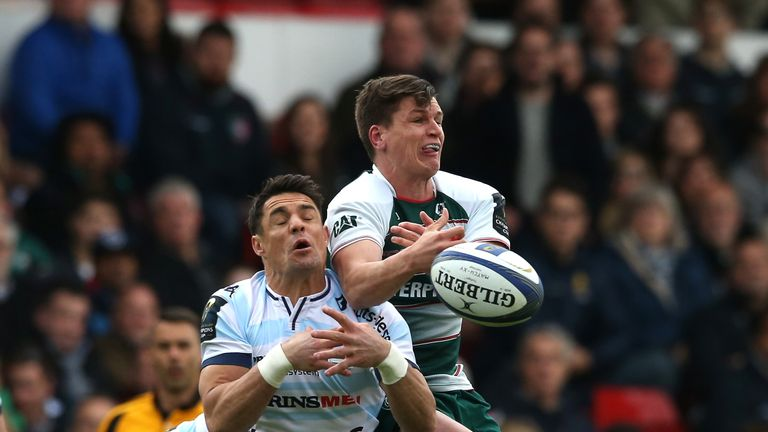 Freddie Burns of Leicester and Racing 92's Dan Carter compete for the ball