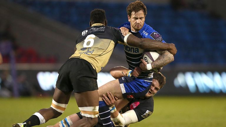 Danny Cipriani is tackled by Montpellier's Fulgence Ouedraogo