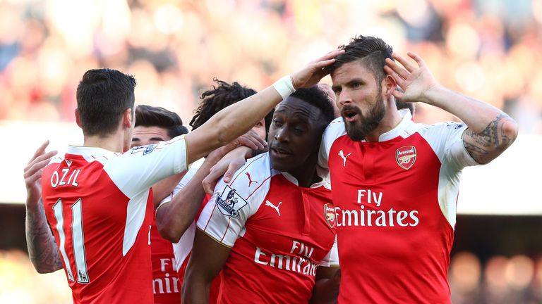 Danny Welbeck of Arsenal celebrates scoring the opening goal with Olivier Giroud (R)